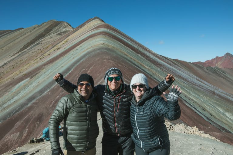 rainbow mountain peru tour group summit guide