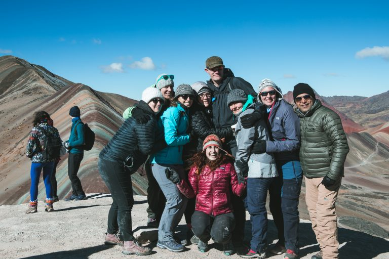 rainbow mountain peru tour group happy