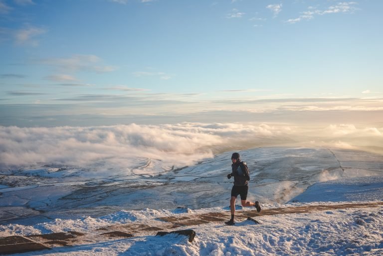 golden hour pen y ghent yorkshire dales trail running man snow