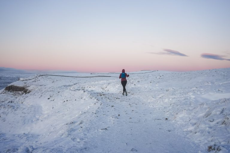 sunset pen y ghent yorkshire dales trail running woman snow
